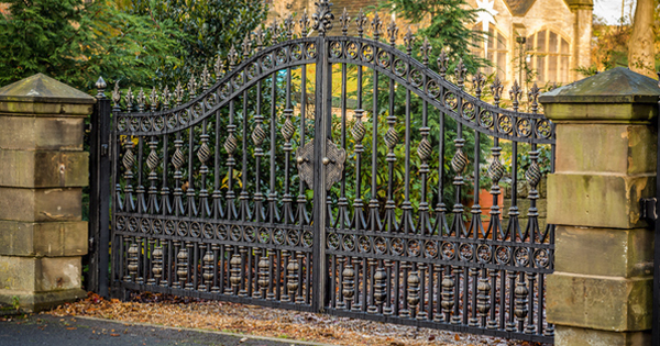 Quality iron gates, wrought iron gate posts, metal security gates and many more cast iron style ironwork by North Valley Forge, one of the UK's largest manufacturers and installers of ornamental wrought iron style gates and solid wooden driveway gates and decorative cast iron garden railings. We supply wholesale iron gate parts to the trade with over 4500 unique iron gate components to offer a limitless number of design combinations for antique looking narrow and wide gates. Over 30 years experience installing and manufacturing metal garden gates metal side gates metal estate gates metal driveway gates metal gate posts and garden gates and at any size you want, we can forge a bespoke set of privacy gates to your exact requirements ? simply call us for help and gate sales prices. For over 30 years North Valley Forge have designed, manufactured and installed quality gates from our Lancashire factory and deliver directly to our customers Nationwide. Iron gate showrooms are located in the North West at Manchester and Burnley, Lancashire. We also have showroom in Birmingham that is ideally located for west midland customers. We can arrange guaranteed delivery to any UK mainland address, some wrought iron projects have required overseas delivery aswell. We offer an exclusive range of standard or tall wrought iron fence panels, buy a made to measure gate, ready made front gate designs from GatesIron. For those customers who are looking where to buy quality unique gate designs ( far from B&Q or Wickes) we offer a dedicated bespoke iron front gates designs. We also supply contemporary metal railings, custom made metal staircases, security grilles, knotted balusters, posts, fittings, accessories and also motorised gate automation. If you need any help at all measuring up for a custom gate installation our professional installers are available throughout the UK to gove the best advice and cost details.
